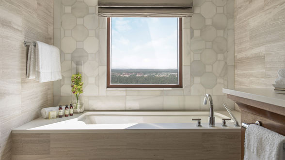 Every room comes with a luxurious bathroom with deep, soaking tubs. (©Four Seasons Orlando)