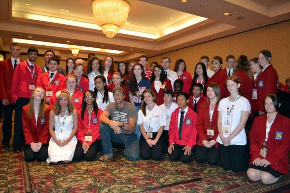 Mike Rowe with a group of students who received SkillsUSA scholarship at a luncheon