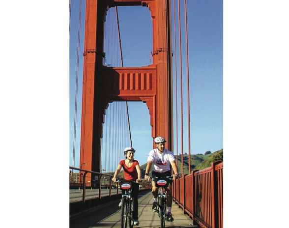 Rent a bike from Blazing Saddles and ride over the Golden Gate Bridge