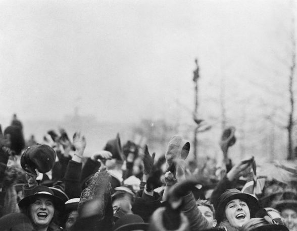 Crowds cheering outside Buckingham Palace, photo in Imperial War Museum, London, UK