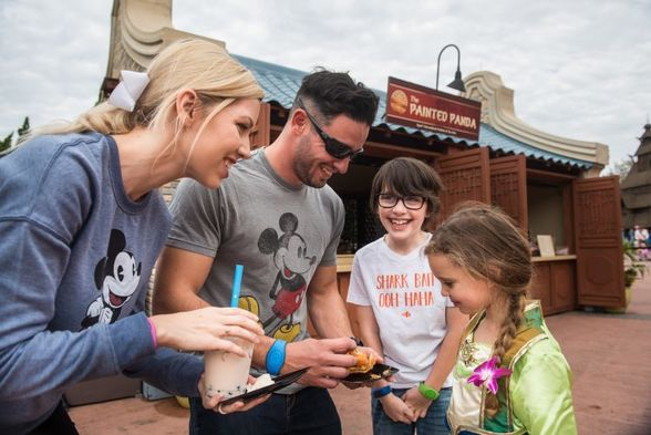 A Family Enjoys Dishes at the Epcot International Festival of the Arts