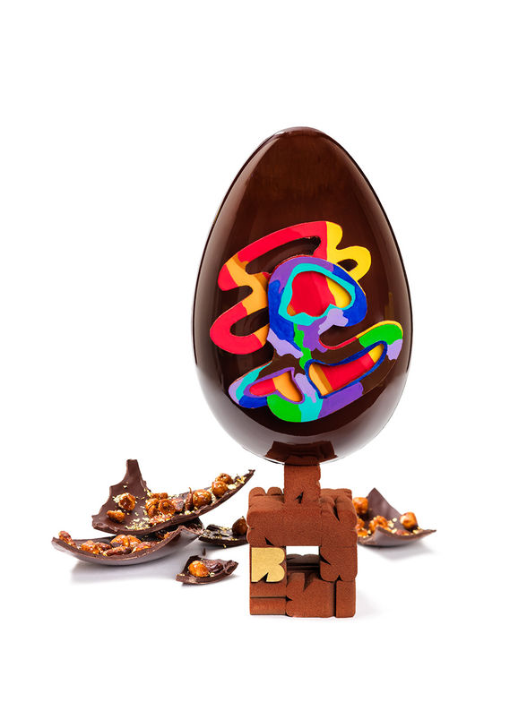 """Pascal Hainigue, the pastry chef at the <a href=""""http://www.leburgundy.com"""" target=""""_blank"""">Burgundy Hotel</a> has turned his creation into a work of art. Taking a cue from French artist Guy de Rougemont, the chef's Easter egg is painted with the artist's love of bright colours on the outside and filled with caramelised nuts on the inside. (Courtesy FrédericBaron)"""