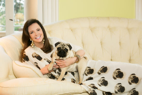 Patricia Altschul wears a custom caftan with photos of her pug on it.