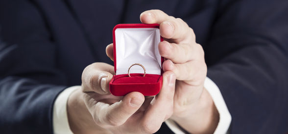 Proposal of marriage with engagement ring, London, UK