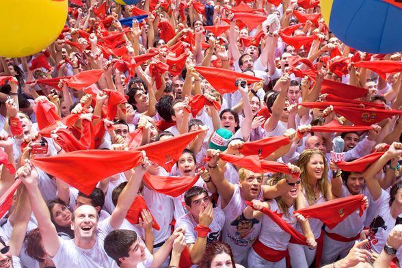 Partiers wave red handkerchiefs during Pamplona's San Fermin Festival
