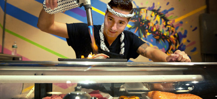 Chef blow torching sushi