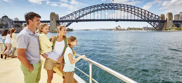 A family enjoys a cruise on Sydney Harbour