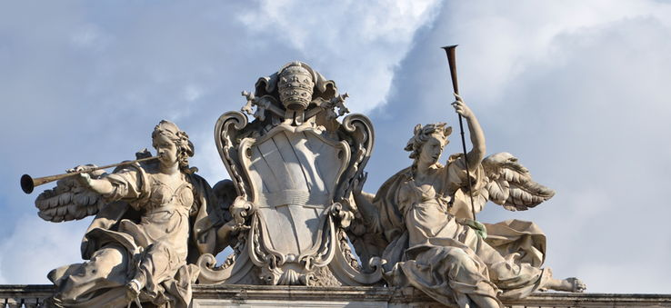 the papal crest on top of the Quirinal Palace, Rome