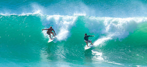 Surfers catching a wave on the Gold Coast