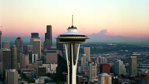 Space Needle and Mount Rainier at sunset