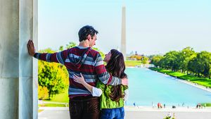 A young couple at the Lincoln Memorial