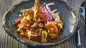 Peruvian dish topped with seafood