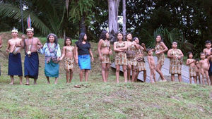 A local tribe greets Rainforest Lodge hotel guests with a song and a dance.