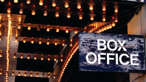 Box office sign under theater lights