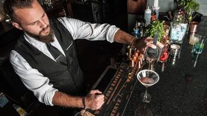 Bartender pours a drink at The Imperial