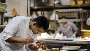 Chef Srijith Gopinathan puts the finishing touches on a dish at Compton Place.