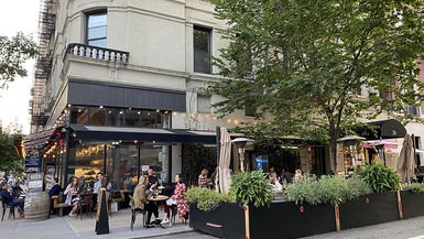 On the Upper East Side, there's no shortage of choices for a satisfying evening. It seems like every restaurant has created an outdoor oasis surrounded by plants, partitions, or under a tent to keep you fed and out on the streets | WhereTraveler