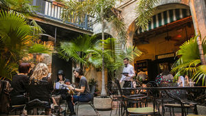 The Napoleon House's centuries-old courtyard makes an idealic French Quarter lunch spot.
