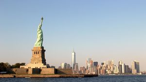 Statue of Liberty with NYC skyline in background