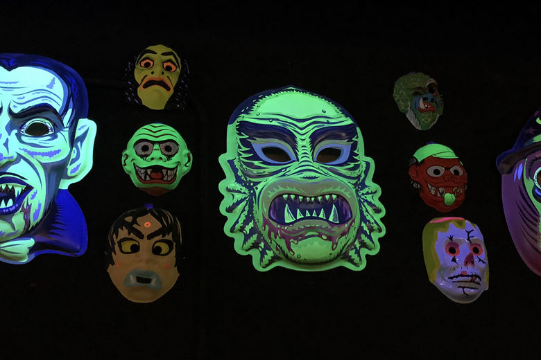 glow in the dark masks on a wall