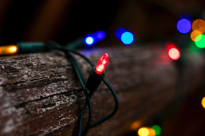 christmas lights around a wooden pole