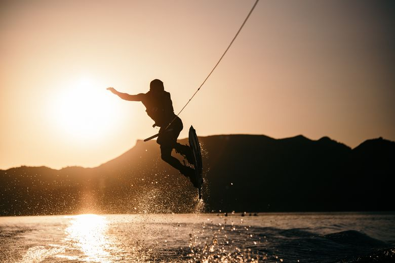 Wakeboarding with a sunset